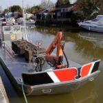 bateau ostreicole avec grue